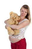 The pregnant woman with a teddy bear Stock Photos