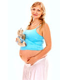 Pregnant woman with teddy bear. Stock Photo