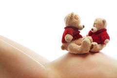 Pregnant woman and teddy bears Stock Photo