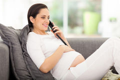 Pregnant woman telephone Stock Images