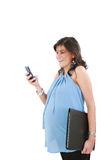 A pregnant woman texting Royalty Free Stock Image