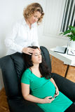 Pregnant woman at therapy Royalty Free Stock Photos