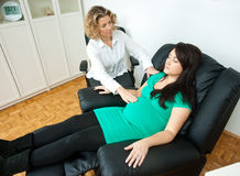 Pregnant woman at therapy Royalty Free Stock Image