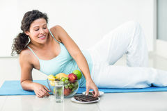 Pregnant woman about to hold chocolate bar Stock Images