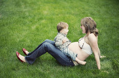 Pregnant woman with toddler son Royalty Free Stock Images