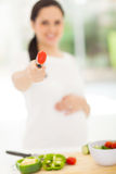 Pregnant woman tomato Royalty Free Stock Image