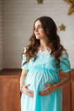 Pregnant woman touching her belly with hands royalty free stock photos