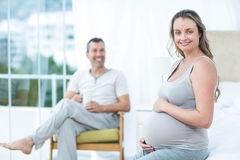 Pregnant woman touching her belly Royalty Free Stock Photos