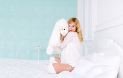 Pregnant woman and toy hare Royalty Free Stock Photo