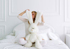Pregnant woman and toy hare Stock Photography