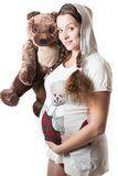 Pregnant woman and toy Teddy bear Royalty Free Stock Image