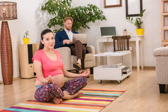 Pregnant Woman Training At Home Royalty Free Stock Photography