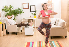 Pregnant Woman Training At Home Royalty Free Stock Photo
