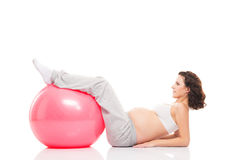 A pregnant woman training with a fitness ball Stock Photography