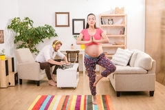 Pregnant woman training at home Royalty Free Stock Photos