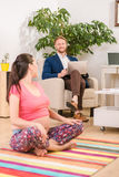 Pregnant woman training at home Stock Image