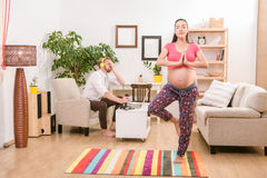 Pregnant woman training at home stock images