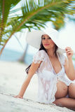 Pregnant woman and Travel. Rest in exotic countries. Sea, beach, palm trees Stock Image