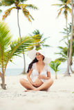 Pregnant woman and Travel. Rest in exotic countries. Sea, beach, palm trees Royalty Free Stock Photos