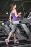 Pregnant woman on the treadmill Stock Photos