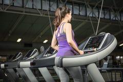 Pregnant woman on treadmill Stock Photos