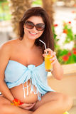 Pregnant woman on tropical resort Stock Images