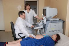 Pregnant woman ultrasound in clinic royalty free stock image