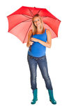 Pregnant woman with umbrella Stock Photos
