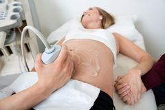 Pregnant Woman Undergoing Ultrasound Royalty Free Stock Images