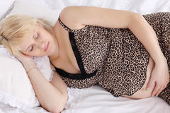 Pregnant woman in underwear sleeps royalty free stock images