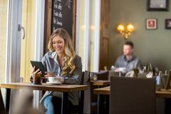 Pregnant Woman Using Digital Table In Cafe Royalty Free Stock Images