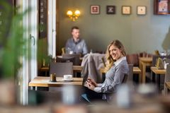 Pregnant Woman Using Digital Tablet At Coffeeshop Stock Image