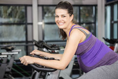 Pregnant woman using exercise bike. At the gym Stock Photography