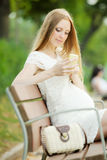 Pregnant woman using mobile Royalty Free Stock Image