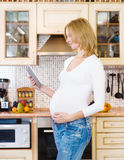 Pregnant woman using a tablet computer Royalty Free Stock Photo