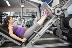 Pregnant woman using weight machine Royalty Free Stock Photo