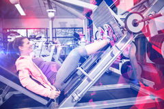 Pregnant woman using weight machine Royalty Free Stock Image
