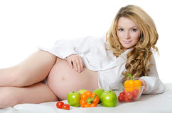 The pregnant woman with Vegetables Stock Photo