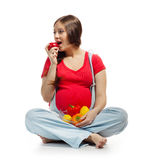 Pregnant woman with vegetables and fruits Royalty Free Stock Photography