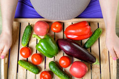 Pregnant woman with vegetables Stock Photography