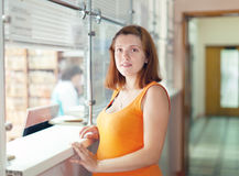 Pregnant woman waiting  for patient's records Royalty Free Stock Image
