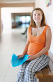 Pregnant woman waits to receive doctor. At the clinic stock photos