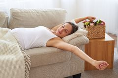 Pregnant woman wakes up and stretches cute. Side view of pregnant woman wakes up and stretches cute Royalty Free Stock Image
