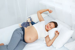 Pregnant Woman waking up in the Morning. Mom Expecting Baby. Bea Royalty Free Stock Images