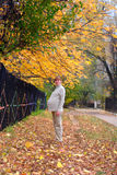 Pregnant woman walk in autumn park. #1 Stock Photos