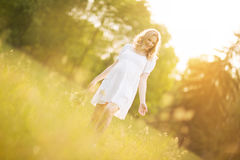 Pregnant woman on a walk in the Park on a Sunny day Stock Photos