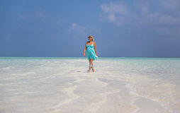 Pregnant woman is walking on island Stock Images