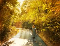The pregnant woman walks on autumn park Stock Photo