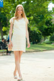 Pregnant woman walks in summer park Royalty Free Stock Images