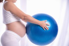 A pregnant woman was to care for the child in the womb of exercise for good health.  royalty free stock images